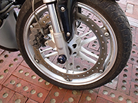 Black Spool Front Axle Slider on Buell XB9S