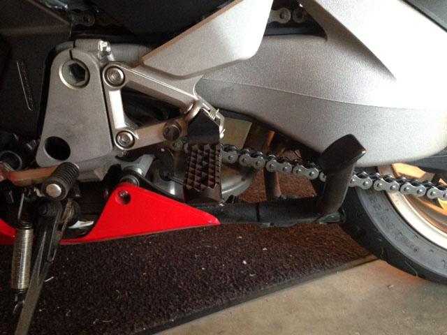 Lowered Black Quadtrax Tread Motorcycle Foot Pegs On Honda VFR
