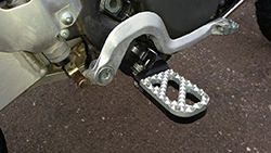Suzuki DR-Z400E motorcycle with Hunter tread KD wide lowered foot pegs, with black base